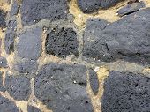 Close-up of a old Cemented lava stone wall with small shells on the Oahu Hawaii. poster