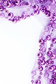 Close up of purple garland. Light background. poster