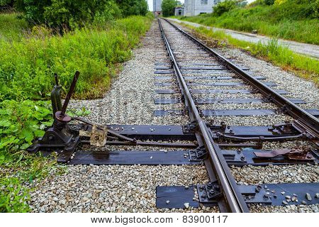 Manual railroad switch on old plant