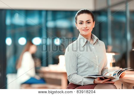 Beautiful young woman having business lunch