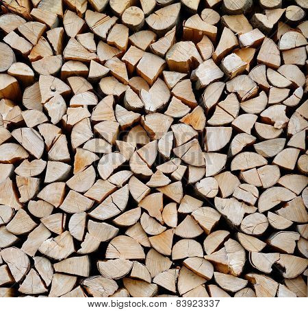 Texture of a stack of chopped firewood