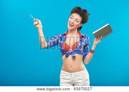 Secretary pin-up girl with a notebook and pen.