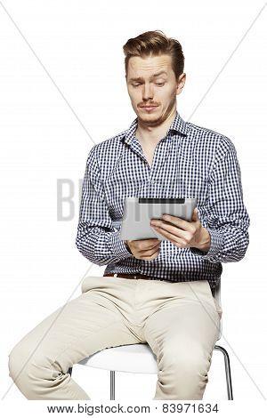 Man Looks On Tablet