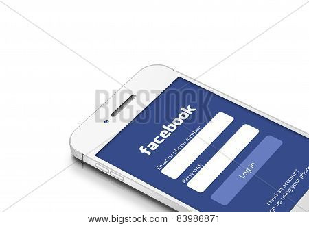 Gdansk, Poland - March 2, 2015: White Mobile Phone With Facebook Social Network Isolated Over White