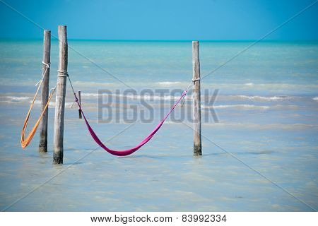 Two Hammock Over Caribbean Sea. Holbox Island Near Cancun. Lonely Paradise. Traveling Through Mexico