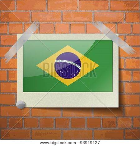 Flags Brazil Scotch Taped To A Red Brick Wall