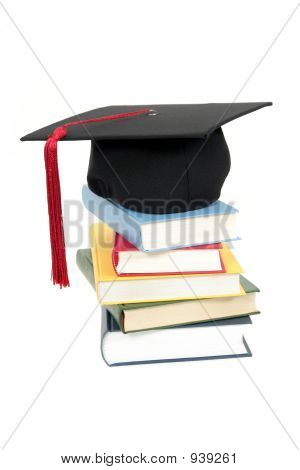 Graduation Cap On Top Of Stack Of Books