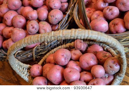Delicious New Potatoes In Baskets On Wood Table