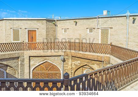 The courtyard of the medieval Caravan Saray used as the tourist hotel Bukhara Uzbekistan. poster