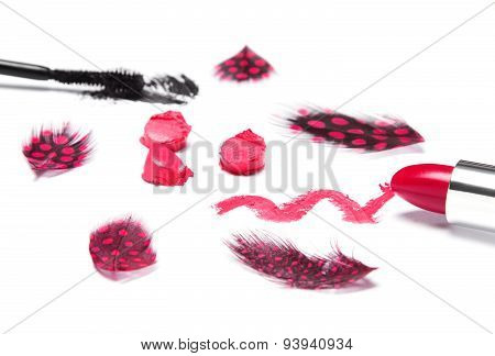 Bright Red Lipstick With Black Mascara And Mottled Feathers