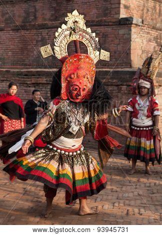 BHAKTAPUR, NEPAL -  APRIL 19, 2013: Unknown Lama performs a ritual dance (Bhairav Dance) .