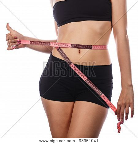 Girl Measuring Waistline And Shows Thumb Up.