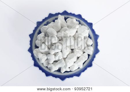 white clay filler or soft-prepared chalk or clay rich in porcelain cups on white background poster