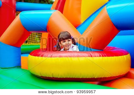 Happy Kid, Having Fun On Inflatable Attraction Playground