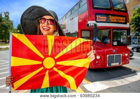 Woman with macedonian flag in Skopje city