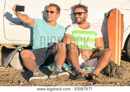 Young Hipster Best Friends Taking A Selfie Sitting Next To The Car - Concept Of Modern Technologies