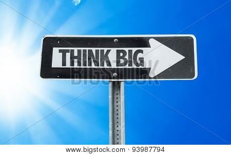 Think Big direction sign with a beautiful day