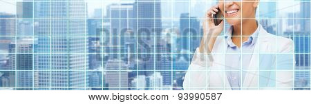 business, people and communication concept - smiling african american businesswoman calling on smart phone over city and blue grid background