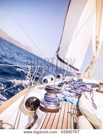 Closeup photo of detail of sailboat, yacht winch with rope on it, traveling along sea on water transport, active lifestyle, summer vacation