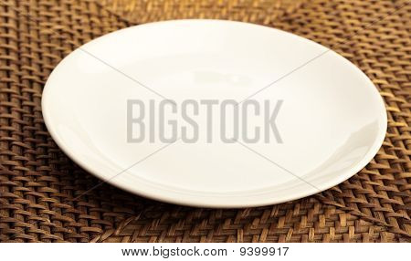Plate On Wicker