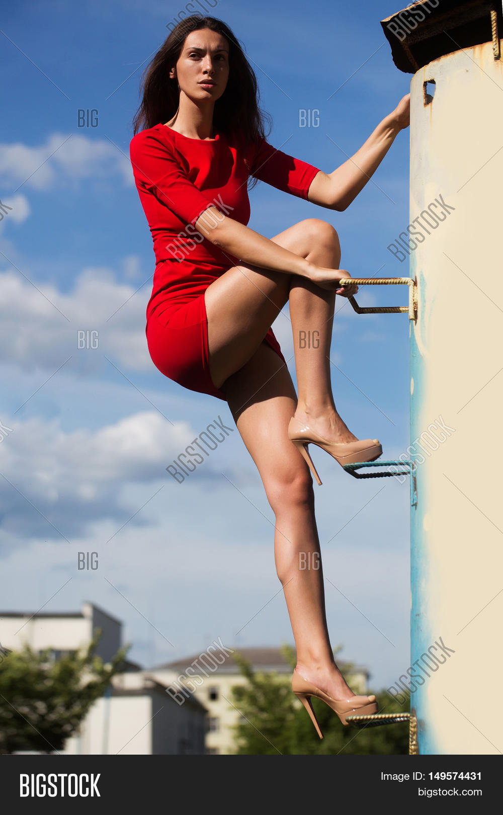 ca3edbb31ff young sexy fashionable woman or girl with long brunette hair and pretty  face in stylish red dress on slim body and shoes on high heels climbing on  house ...