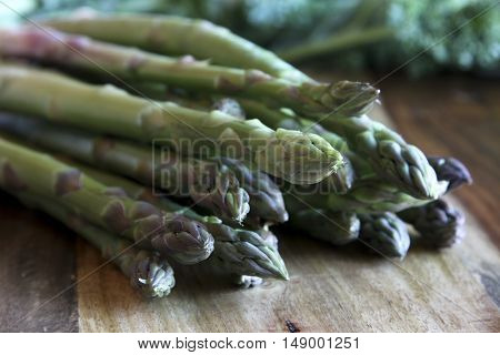Stock image of asparagus taken on a wooden block