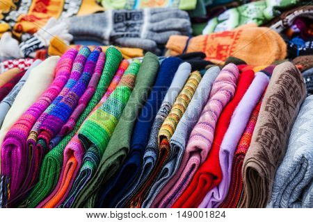 Peruvian scarves and gloves in a street market