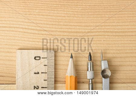 Close-up of the tip of a pencil, compass and centimeter ruler. Engineering tools. Stuff for drawing. School supplies for drawing and geometry lessons.