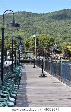 LAKE GEORGE, NY - SEP 24: Village of Lake George in New York, as seen on Sep 24, 2016. Lake George is a long, narrow oligotrophic lake located at the southeast base of the Adirondack Mountains.