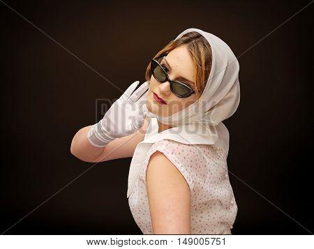 young beautiful girl posing, retro styling, studio shot