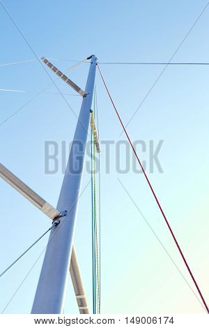 Staysail halyard on the mast, near the spreaders, snrouds and backstay