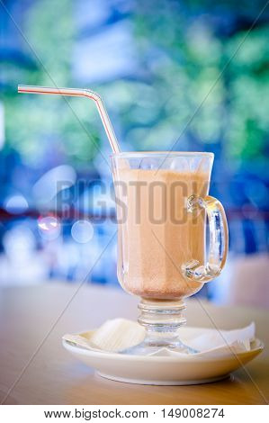 lass of delicious cocoa on a blue background