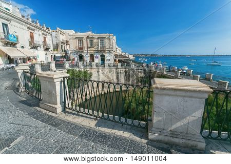 SIRACUSA, ITALY - JUL 26 2016,: Arethuse Fountain and architecture in Old Town of Siracusa, Sicily. Shot in 2016