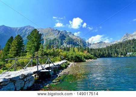 Wide angle landscape shot of glacial lake Popradske pleso in High Tatras.