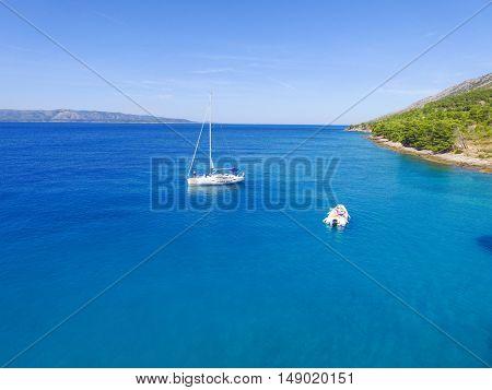 BOL, CROATIA - AUGUST 2014: Aerial view sailing boat off the coast of the island of Brac, near Bol, Croatia