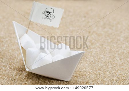 White sugar cubes on a boat in a brown sugar sea
