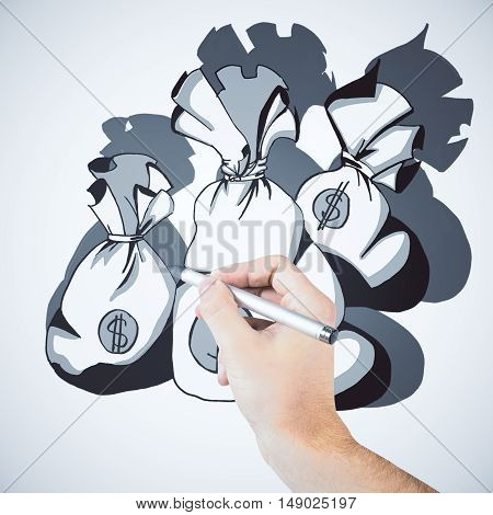 Male hand drawing money sacks on white background. Weath concept
