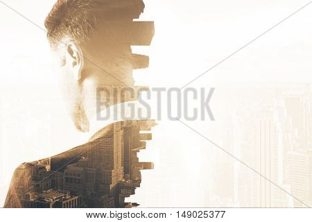 Back view of thoughtful young businessman on abstract city background. Research concept. Double exposure