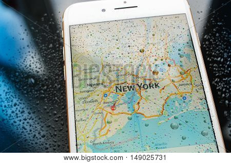 PARIS FRANCE - SEP 26 2016: New Apple iPhone 7 Plus unboxing and testing - New York map on smartphone under rain. New iPhone7 is one of the best waterproof smart phone in the world