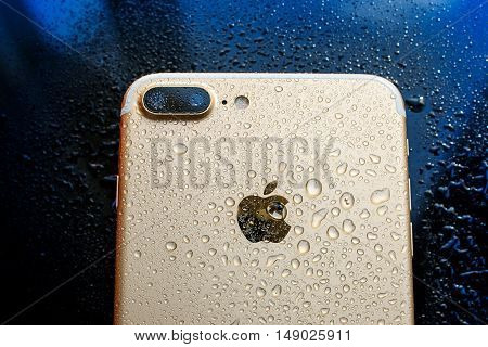 PARIS FRANCE - SEP 26 2016: New Apple iPhone 7 Plus unboxing and testing - rear view of water splashed phone. New iPhone7 is one of the best waterproof smart phone in the world