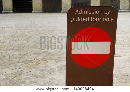 Sign Saying Admission By Guided Tour Only