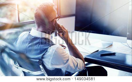 Closeup Bearded Businessman Wearing White Shirt Waistcoat Working Modern Loft Startup Computer.Creative Young Man Using Mobile Phone Call Business Meeting.Person Work Digital Tablet Desktop Table