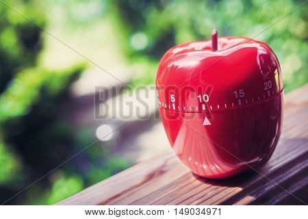 10 Minute Kitchen Egg Timer In Apple Shape Standing On A Handrail
