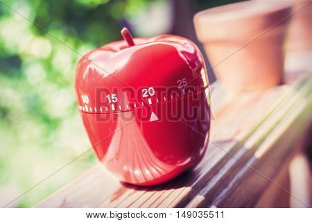 20 Minute Kitchen Egg Timer In Apple Shape Standing On A Handrail