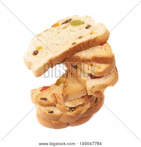 rwisted stack of rusks with the pieces of dried fruits isolated over the white background