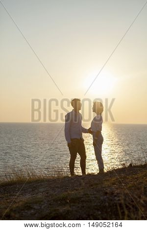Silhouette Photography Of Couples Younger Man And Woman Standing Against Sun Set Sky