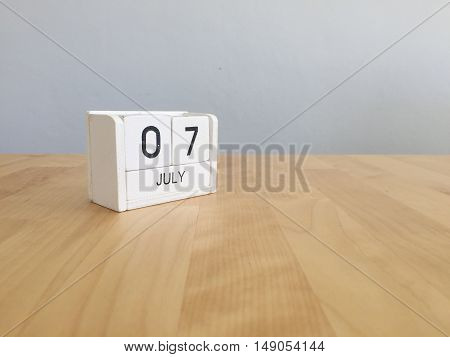 July 7Th.july 7 White Wooden Calendar On Vintage Wood Abstract Background. Summer Day.copyspace For