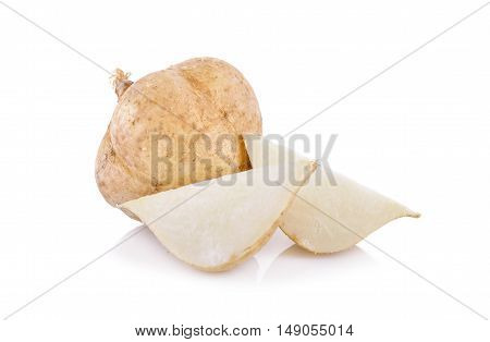 whole and cut yam bean or jicama on white background