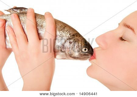 Beautiful Young Woman Kissing A Fish