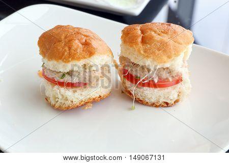 Mini tuna fish burger Asian style fusion on white plate
